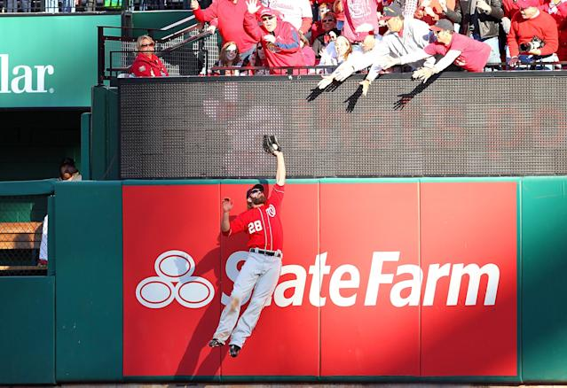 ST LOUIS, MO - OCTOBER 07: Jayson Werth #28 of the Washington Nationals makes a catch at the wall to save a home run in the sixth inning against the St Louis Cardinals during Game One of the National League Division Series at Busch Stadium on October 7, 2012 in St Louis, Missouri. (Photo by Dilip Vishwanat/Getty Images)