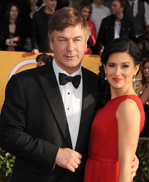 FILE - In this Jan. 27, 2013 file photo, Alec Baldwin, left, and Hilaria Thomas arrive at the 19th Annual Screen Actors Guild Awards at the Shrine Auditorium in Los Angeles. A Canadian bit-part actress, Genevieve Sabourin (ZHAHN'-vee-ehv sah-boor-EH'), is accused of barraging Baldwin with lovesick, demanding messages and showing up outside his New York apartment building. Her trial opened Thursday, Nov. 7, 2013, in Manhattan. (Photo by Jordan Strauss/Invision/AP, File)