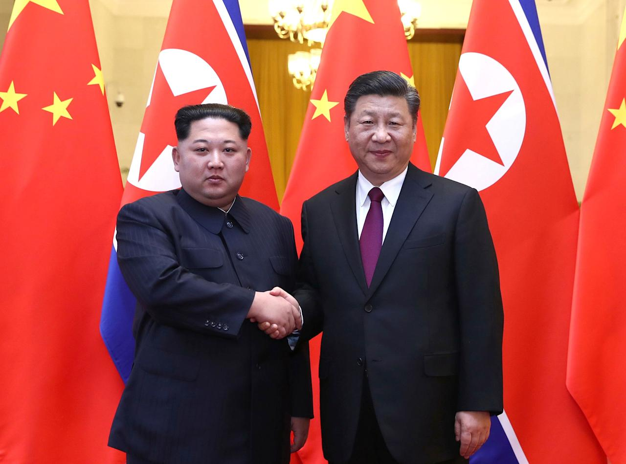 <p>North Korean leader Kim Jong Un and Chinese President Xi Jinping shake hands at the Great Hall of the People in Beijing, China, in this picture released to Reuters on March 28, 2018. (Photo: Ju Peng/Xinhua via Reuters) </p>