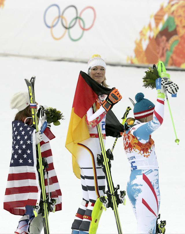Women's supercombined medalists, from left United States' Julia Mancuso, bronze, Germany's Maria Hoefl-Riesch, gold, and Austria's Nicole Hosp, silver, stand on the podium during a flower ceremony at the Alpine ski venue at the Sochi 2014 Winter Olympics, Monday, Feb. 10, 2014, in Krasnaya Polyana, Russia. (AP Photo/Charles Krupa)