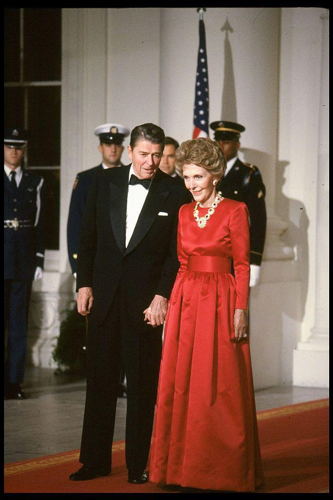 <p>At a State Dinner honoring British Prime Minister Margaret Thatcher, the Reagans held hands while posing on the red carpet. </p>
