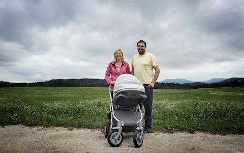 Simon Marolt, 37, and his wide, Suzanna, 28, pose for photographs on their farm in Bloke, where there are bear sightings nearly every day - Credit: Uros Abram