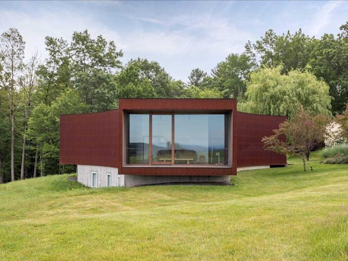 The guest house of the Tsai Residence is clad in a rusted Corten steel.