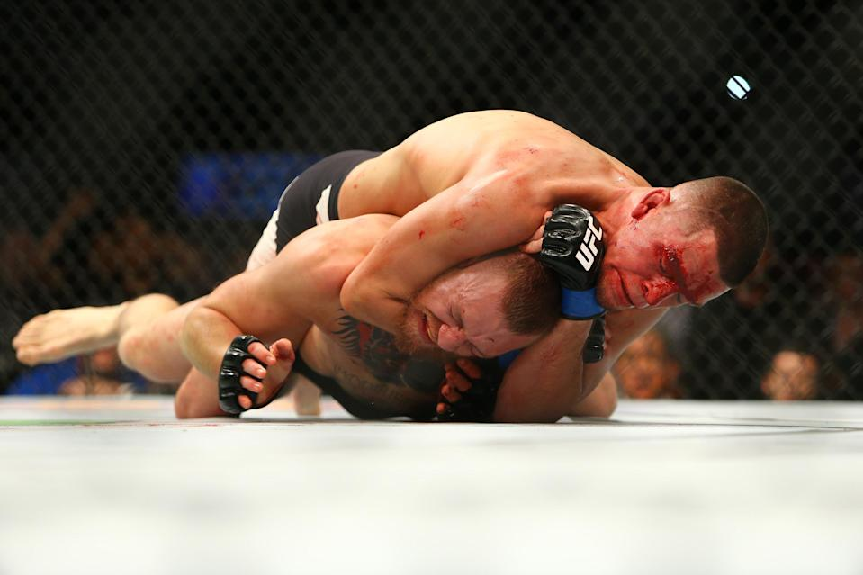 Nate Diaz applies a choke hold to win by submission against Conor McGregor during UFC 196 at the MGM Grand Garden Arena on March 5, 2016 in Las Vegas. (Getty Images)