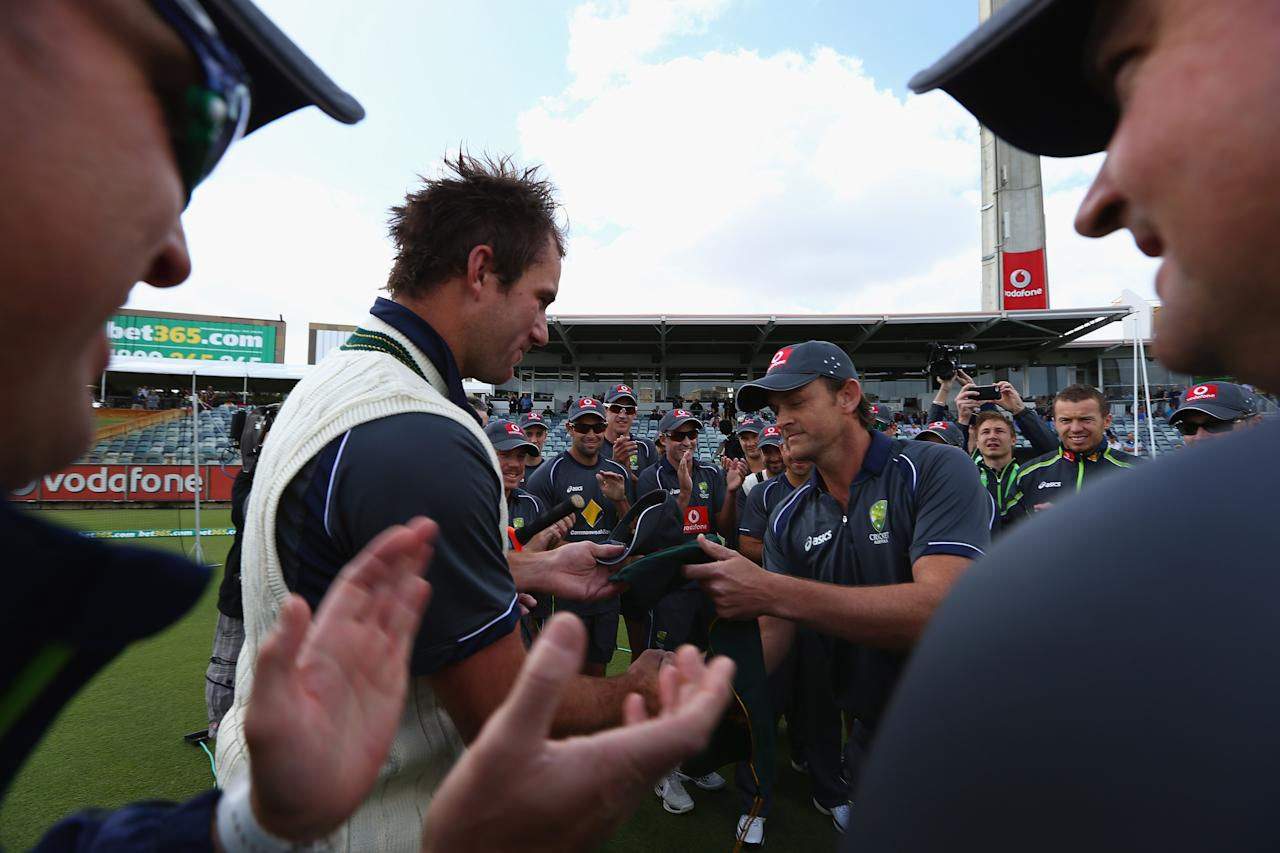 PERTH, AUSTRALIA - NOVEMBER 30: John Hastings of Australia is presented with the baggy green cap by former Australian cricketer Adam Gilchrist prior to the start of play on day one of the Third Test Match between Australia and South Africa at the WACA on November 30, 2012 in Perth, Australia. (Photo by Robert Cianflone/Getty Images)