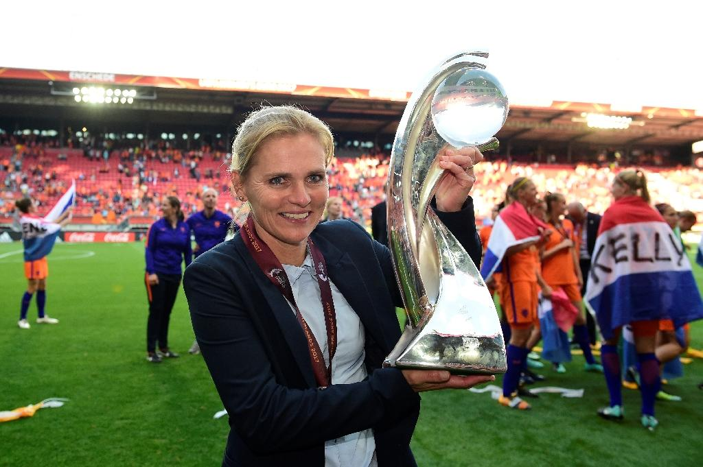 Netherlands' head coach Sarina Wiegman celebrates with the trophy after winning with her team the UEFA Women's Euro 2017 tournament final match against Denmark, at FC Twente Stadium in Enschede, on August 6, 2017 (AFP Photo/Tobias SCHWARZ                     )