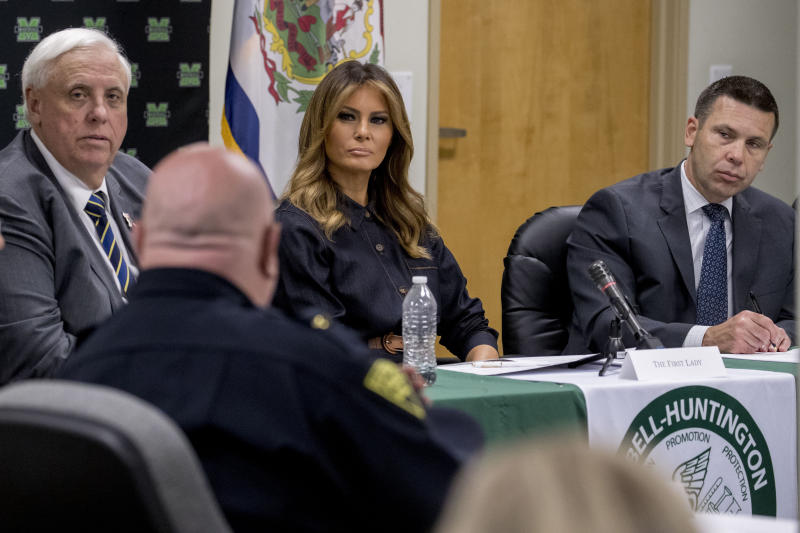West Virginia Gov. Jim Justice, left, first lady Melania Trump, center, and Acting Homeland Security Secretary Kevin McAleenan, right, listen as Huntington Police Chief Hank Dial, foreground, speaks during a roundtable on the opioid epidemic at Cabell-Huntington Health Center in Huntington, WVa., Monday, July 8, 2019. (AP Photo/Andrew Harnik)