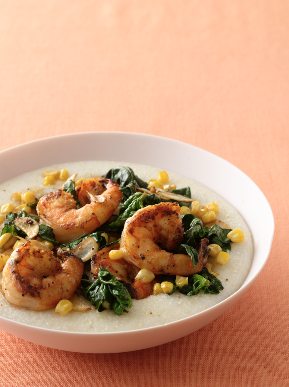 """<p>This Southern dish is all about balance, with sweet corn and creamy grits offsetting the heat of the Cajun seasoning.</p><p><em><a href=""""https://www.goodhousekeeping.com/food-recipes/a13679/cajun-shrimp-spinach-and-grits-recipe/"""" rel=""""nofollow noopener"""" target=""""_blank"""" data-ylk=""""slk:Get the recipe for Cajun Shrimp, Spinach & Grits »"""" class=""""link rapid-noclick-resp"""">Get the recipe for Cajun Shrimp, Spinach & Grits »</a></em></p>"""