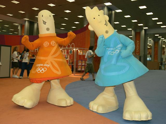 ATHENS, GREECE - AUGUST 10: The Offical Mascots of the Athens 2004 Olympic Summer Games Athena (L) and Phevos (R) walk through the lobby of the Main Press Center (MPC) prior to the start of games August 10, 2004 in Athens, Greece. The games kickoff with the Opening Ceremonies on August 13. (Photo by Scott Halleran/Getty Images)