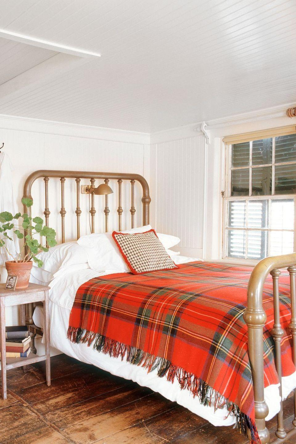 <p>Even your bedroom could use a winter refresh: Keep it simple by dressing the bed with a plaid throw pillow and coordinating blanket. </p>