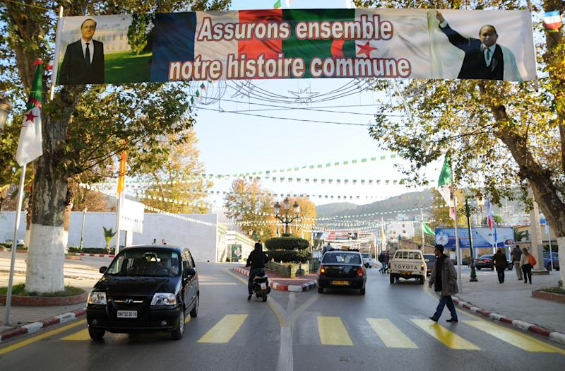 "Cars drive under a banner reading ""Accepting together our common history"" Wednesday, Dec.19, 2012 in Tlemcen, northwest Algeria. French President Francois Hollande is hoping for a clean start and an end to tensions with Algeria during a state visit to the country that was once the French empire's most-prized colony. The two-day state visit by the Socialist president, which begins Wednesday, comes as Algeria celebrates 50 years since its independence from France after a brutal seven-year war — and 130 years of colonial rule. Hollande will travel to Algiers and Tlemcen. (AP Photo/Nadji)"