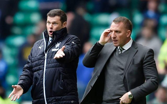 """Brendan Rodgers last night condemned the Rangers board for their treatment of Graeme Murty, saying that the Rangers interim manager had been 'thrown in below the bus' in successive Old Firm humiliations. On Sunday, Celtic secured a seventh successive Scottish title – their 49th in total – with a 5-0 drubbing of Rangers to follow their similarly dominant display in the William Hill Scottish Cup semi-final at Hampden Park. Murty, originally the under-20 coach, was in charge on both occasions in his interim capacity but, in the lead-up to the Hampden match, the Rangers chairman, Dave King, sent a letter to the club's season ticket holders saying that 'whoever is appointed' as manager for next season would be expected to bring 'immediate success'. Last week, with another high-octane Old Firm collision looming, word emerged that the Rangers board was in pursuit of Steven Gerrard. Once more, Murty was forced to address intense speculation on the eve of the most difficult fixture in Rangers' calendar. On advice from those around him behind the scenes, Murty did not speak to the media after Sunday's crushing defeat, not did Rangers put up any players for interview, which prompted widespread criticism, but Rodgers spoke up for his Ibrox counterpart. """"I have real empathy for Graeme Murty,"""" The Celtic boss said. """"What that guy has had to go through in the build-up to big games, I have really felt for him. Talk about his role and his position? """"This is a guy who, at this time last year, was heralded as a very good coach for young players and I'm sure with first-team players as well, wanting to go into sessions because he really enjoyed his work."""" Murty's side suffered a 5-0 defeat to champions Celtic Credit: PA Of Murty's first spell as interim manager, between the departure of Mark Warburton and the appointment of Pedro Caixinha – during which time Rangers emerged with a 1-1 draw from a league visit to Parkhead, Rodgers said: """"He goes into the role and does a real good job in """