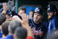 Atlanta Braves' Freddie Freeman high-fives teammates in the dugout after hitting a solo home run during the first inning of a baseball game against the Cincinnati Reds in Cincinnati, Thursday, June 24, 2021. (AP Photo/Aaron Doster)
