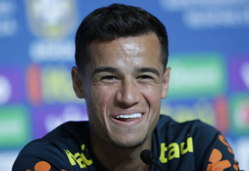 Brazil's Philippe Coutinho smiles during a press conference in Sochi, Russia, Tuesday, June 19, 2018. Brazil will face Costa Rica on June 22 in the group E for the soccer World Cup. (AP Photo/Andre Penner)