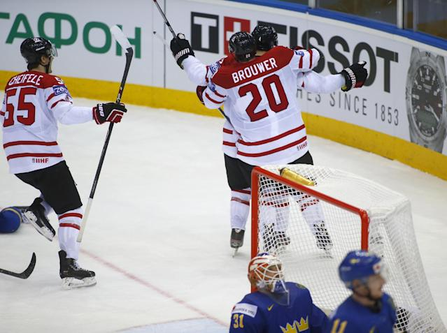 Canada's players celebrate after Ryan Ellis scored against Sweden during the Group A preliminary round match at the Ice Hockey World Championship in Minsk, Belarus, Sunday, May 18, 2014. (AP Photo/Sergei Grits)
