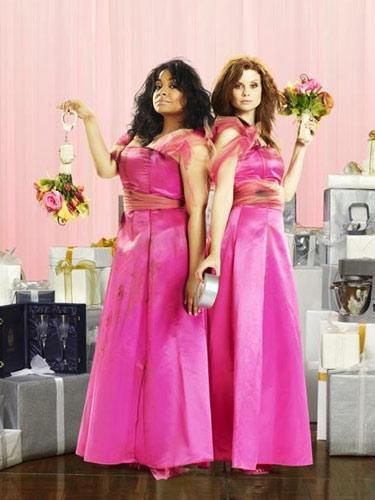 """<div class=""""caption-credit""""> Photo by: Courtesy of Revenge of the Bridesmaids</div><div class=""""caption-title""""></div>Even if you never watched ABC Family's <i>Revenge of the Bridesmaids</i>, you can see how these dated, bright pink satin numbers might have something to do with the main characters' unlimited ire. Read More: 50 Stylish and Affordable Sundresses"""