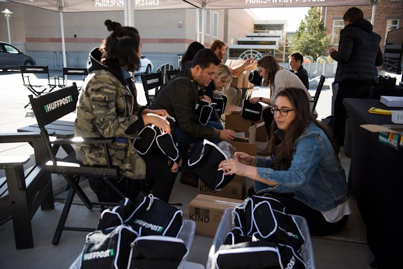 HuffPost and Peak XV staff put together swag bags before events get rolling in Provo.
