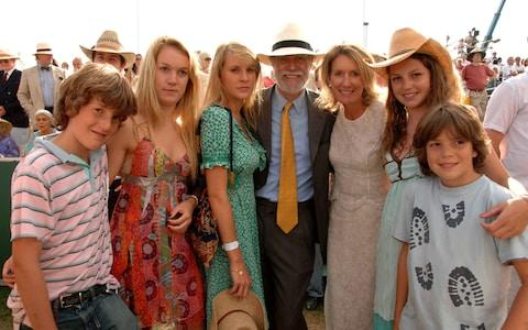 Lord Michael and Lady Marina Cowdray with their five children at the Veuve Clicquot Gold Cup Polo Final at Cowdray Park in 2006 - Credit: Alan Davidson/REX