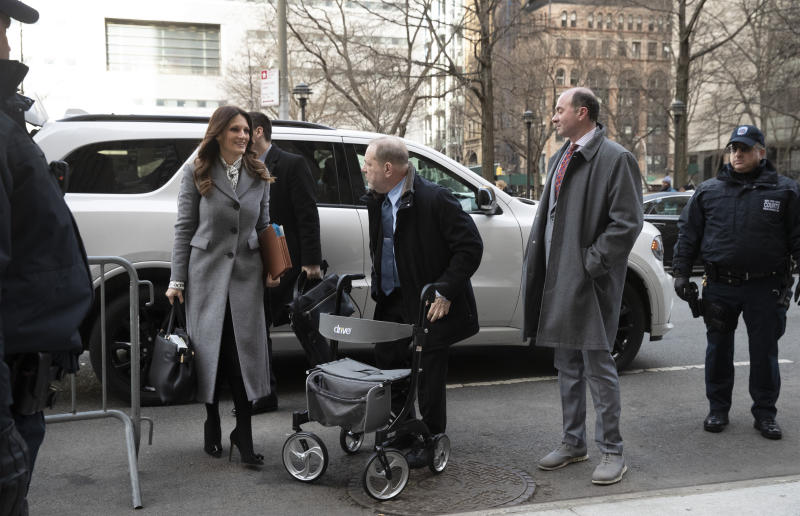 Harvey Weinstein, center, arrives at court with his attorney Donna Rotunno, left, for his trial on charges of rape and sexual assault, Wednesday, Jan. 29, 2020 in New York. (AP Photo/Mark Lennihan)