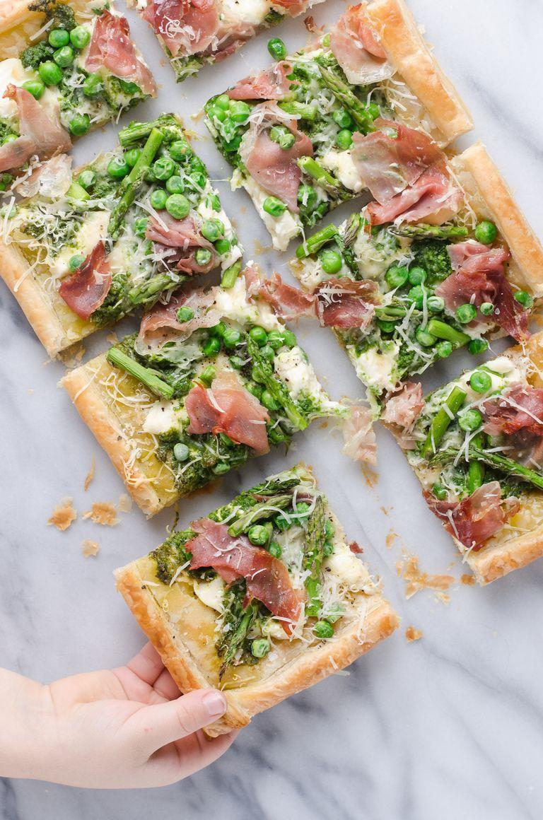 """<p>This puff pastry tart is topped with fresh spring veggies, including asparagus and peas. It's perfect for brunch or a dinner starter.</p><p><a href=""""https://www.thepioneerwoman.com/food-cooking/recipes/a101104/spring-puff-pastry-tart/"""" rel=""""nofollow noopener"""" target=""""_blank"""" data-ylk=""""slk:Get the recipe."""" class=""""link rapid-noclick-resp""""><strong>Get the recipe.</strong></a></p><p><a class=""""link rapid-noclick-resp"""" href=""""https://go.redirectingat.com?id=74968X1596630&url=https%3A%2F%2Fwww.walmart.com%2Fsearch%2F%3Fquery%3Dparchment%2Bpaper&sref=https%3A%2F%2Fwww.thepioneerwoman.com%2Ffood-cooking%2Fmeals-menus%2Fg35585877%2Feaster-recipes%2F"""" rel=""""nofollow noopener"""" target=""""_blank"""" data-ylk=""""slk:SHOP PARCHMENT PAPER"""">SHOP PARCHMENT PAPER</a></p>"""