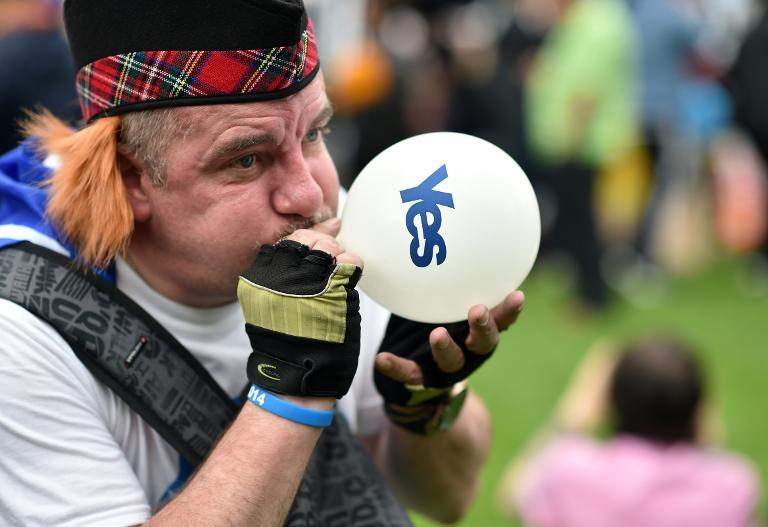 A pro-independence supporter makes his views known in Glasgow's George Square on September 17, 2014