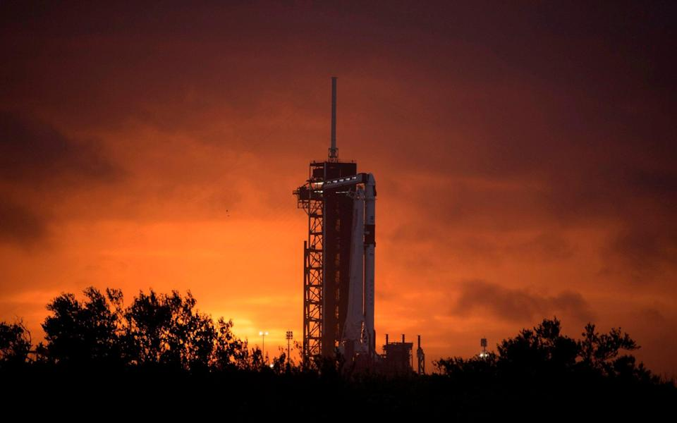 A SpaceX Falcon 9 rocket with the company's Crew Dragon spacecraft onboard on the launch pad at Launch Complex 39A as preparations continue for the Demo-2 mission - BILL INGALLS/AFP