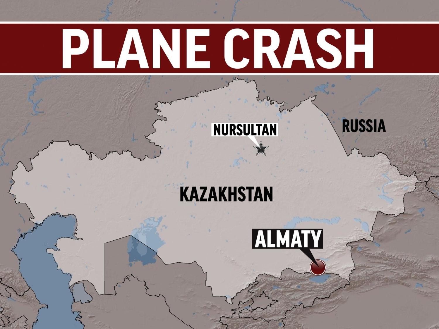 Kazakhstan shaded relief map highlighted, with NURSULTAN (capital) and ALMATY locators, with lettering PLANE CRASH, finished graphic