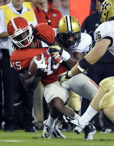 Georgia wide receiver Marlon Brown (15) is brought down by Vanderbilt defensive back Andre Hal during the first quarter of an NCAA college football game on Saturday, Sept. 22, 2012, in Athens, Ga. (AP photo/John Amis)