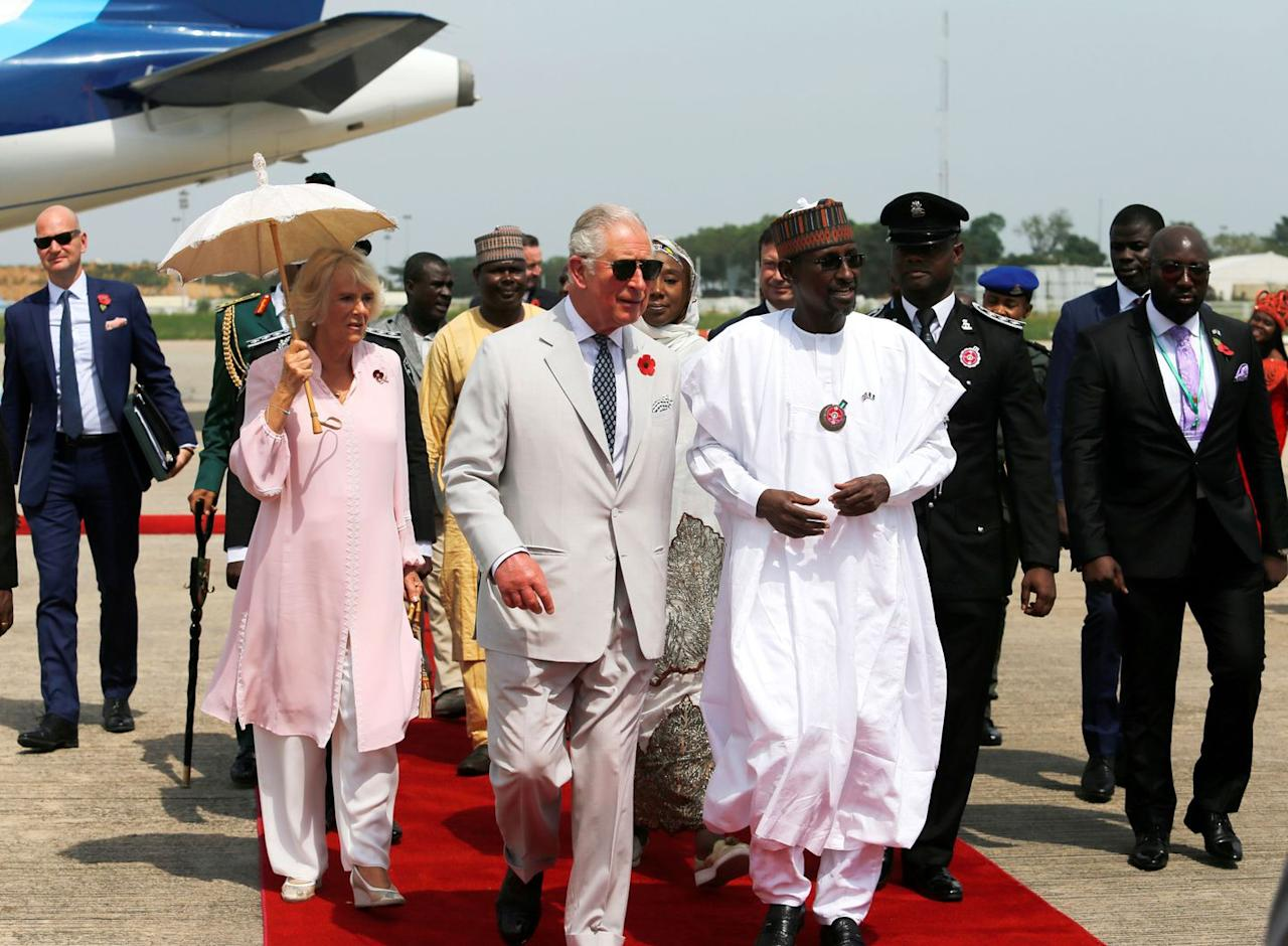 <p>Prince Charles and Camilla arrive in Abuja, their first stop in Nigeria. The couple announced that they will be cancelling their  stop to Jos due to security concerns. </p>