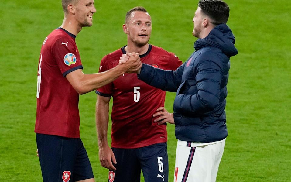 England's Declan Rice, right, shakes hands with Czech Republic's Tomas Soucek, left, and Vladimir Coufal - AP
