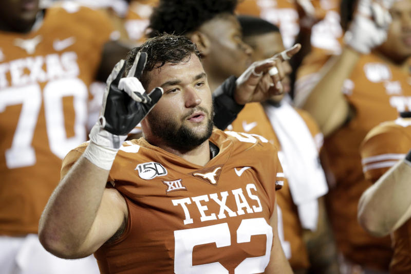 AUSTIN, TX - SEPTEMBER 21: Samuel Cosmi #52 of the Texas Longhorns celebrates with teammates after the game against the Oklahoma State Cowboys at Darrell K Royal-Texas Memorial Stadium on September 21, 2019 in Austin, Texas. (Photo by Tim Warner/Getty Images)