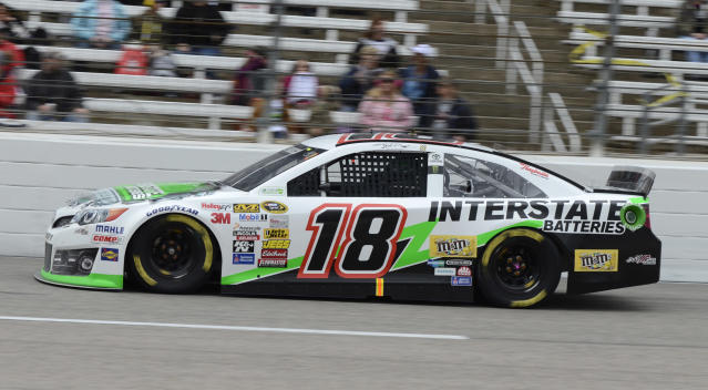 Kyle Busch (18) takes Turn 4 during the NASCAR Sprint Cup series auto race at Texas Motor Speedway, Monday, April 7, 2014, in Fort Worth, Texas. (AP Photo/Larry Papke)