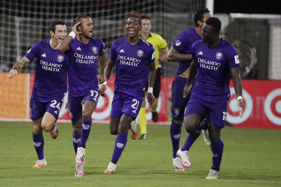Orlando City forward Nani (17) celebrates after scoring the winning goal with teammates Kyle Smith (24), Andres Perea (21), Antonio Carlos (25) and Daryl Dike (18) after an MLS soccer match, against Los Angeles FC, Friday, July 31, 2020, in Orlando, Fla. (AP Photo/John Raoux)