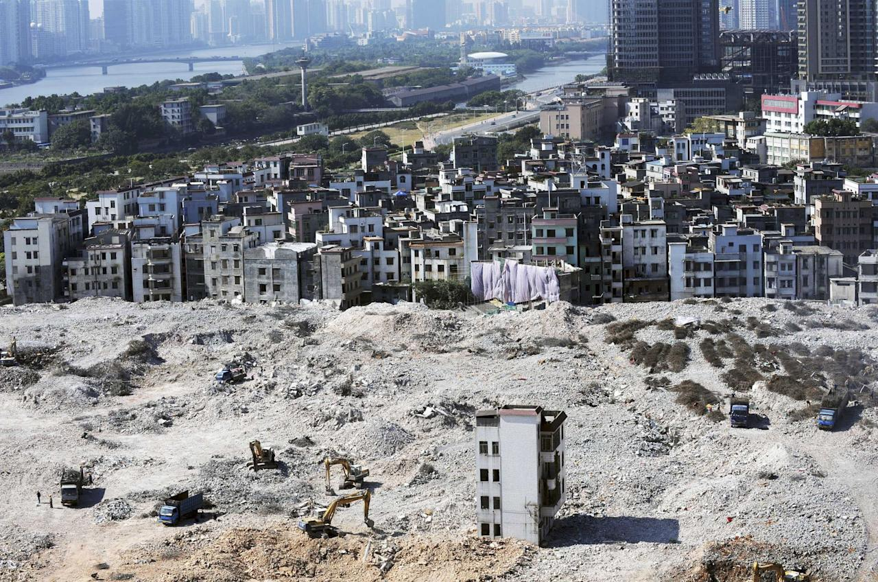 A residential building stands alone in a construction site in 2007. Li Zemin, one of the owners refuses to allow the workers to enter (Rex Features)