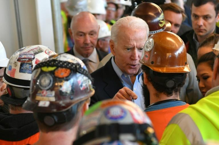 Democratic presidential candidate Joe Biden is confronted as he meets workers as he tours the Fiat Chrysler plant in Detroit, Michigan on March 10, 2020