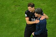 Leon Goretzka celebrates with coach Joachim Loew after scoring the goal against Hungary that took Germany through to a last-16 clash with England