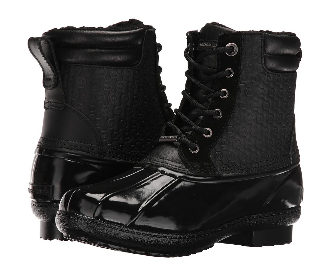 """<p>Kors perfected the snow boot with these versatile black lace-up booties that you'll undoubtedly use every day.</p> <p>$185 