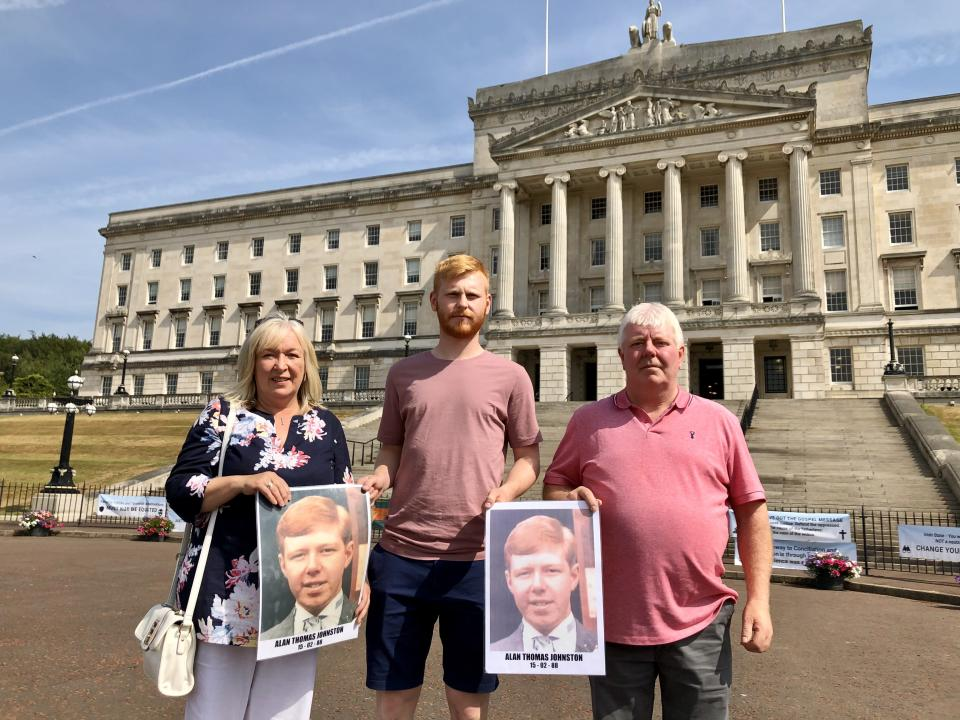 Sandra Harrison and Ian Johnston hold pictures of their murdered brother Alan Johnston. Joining them is Ian's son who was named Alan after his uncle (David Young/PA)