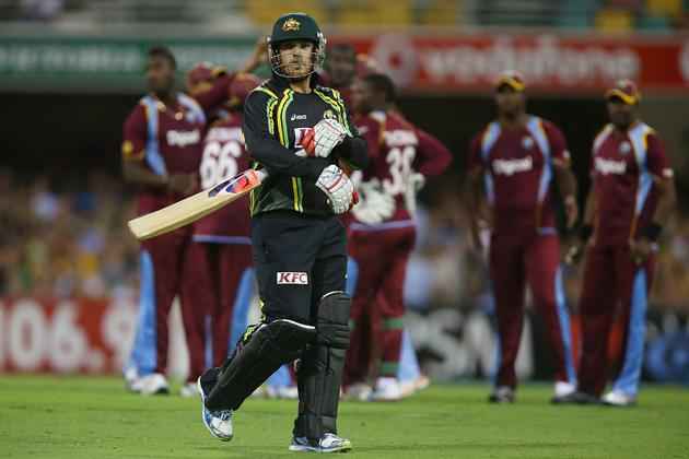 BRISBANE, AUSTRALIA - FEBRUARY 13:  Aaron Finch of Australia leaves the field after being dismissed by Darren Sammy of the West Indies during the International Twenty20 match between Australia and the West Indies at The Gabba on February 13, 2013 in Brisbane, Australia.  (Photo by Chris Hyde/Getty Images)