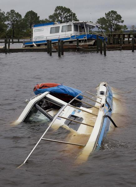 Boats are sunken and thrown up on a dock at the Rock Landing Marina in Panacea, Fla., Tuesday, June 26, 2012. High winds and heavy rains spawned by the approaching Tropical Storm Debby caused the damage. (AP Photo/Dave Martin)