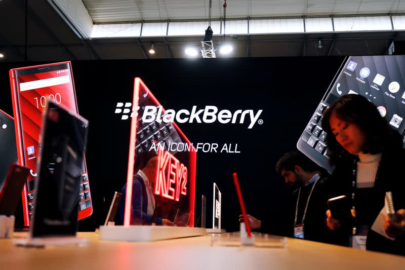 Visitors attend the Blackberry booth at the Mobile World Congress in Barcelona