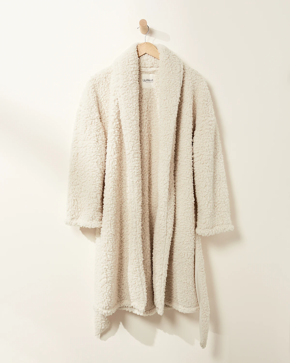 """<h3><h2>UpWest Sherpa Robe</h2></h3><br>This super-snuggly robe situation is crafted from a sherpa-soft fabric and is specifically designed to wrap completely around you like a blanket.<br><br><strong>UpWest</strong> Sherpa Robe, $, available at <a href=""""https://go.skimresources.com/?id=30283X879131&url=https%3A%2F%2Fupwest.com%2Fproducts%2Fbeau-sherpa-women-robe"""" rel=""""nofollow noopener"""" target=""""_blank"""" data-ylk=""""slk:UpWest"""" class=""""link rapid-noclick-resp"""">UpWest</a>"""