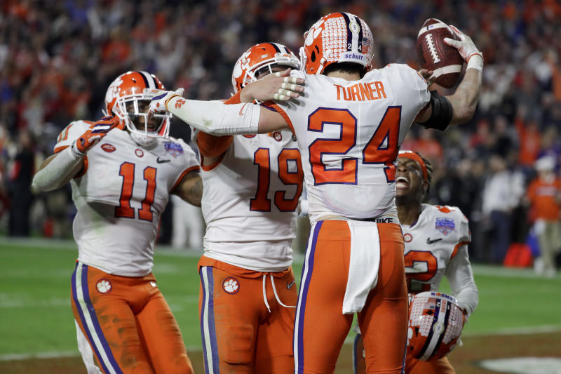 Clemson safety Nolan Turner (24) celebrates after his interception against Ohio State in the final minute of the Fiesta Bowl NCAA college football playoff semifinal Saturday, Dec. 28, 2019, in Glendale, Ariz. (AP Photo/Rick Scuteri)