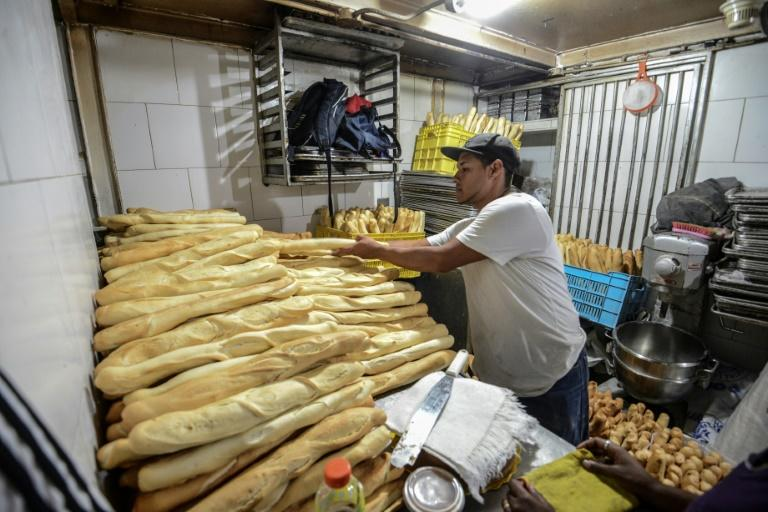 Members of a pro-government community organisation work in an expropriated bakery in Caracas