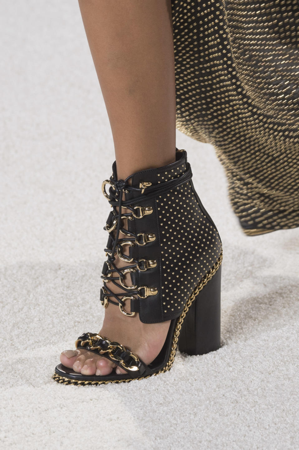 <p><i>Black and gold detailed heels from the SS18 Balmain collection. (Photo: ImaxTree) </i></p>