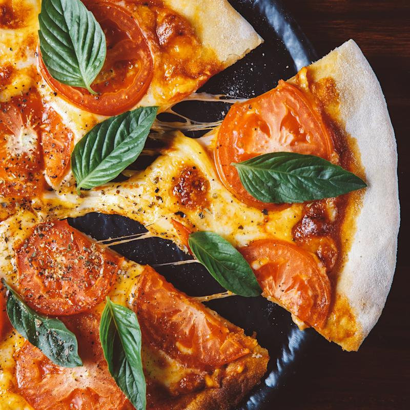 This Hack For Reheating Leftover Pizza Guarantees a Crispy Crust and Perfectly Melted Cheese
