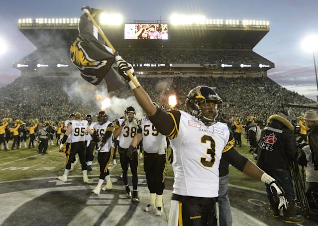 Hamilton Tiger-Cats linebacker Marc Beswick leads his team onto the field face the Saskatchewan Roughriders in the Grey Cup, Sunday, Nov, 24, 2013, in Regina, Saskatchewan. (AP Photo/The Canadian Press, Frank Gunn)