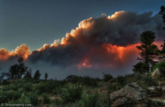 """""""There's quite a fire burning west of Fort Collins, Colorado. It created some pretty spectacular views as the setting sun shone through the clouds and smoke,"""" Brian Emory who took this shot of the High Park Fire on June 10, 2012, wrote on <a hr"""