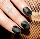 """Glossy or matte, the dark can be spooky. Try <a href=""""https://shop-links.co/1719504990978064723"""" rel=""""nofollow noopener"""" target=""""_blank"""" data-ylk=""""slk:Sally Hansen Miracle Gel in Onyx-pected"""" class=""""link rapid-noclick-resp"""">Sally Hansen Miracle Gel in Onyx-pected</a> layered with the <a href=""""https://shop-links.co/1719504940928716559"""" rel=""""nofollow noopener"""" target=""""_blank"""" data-ylk=""""slk:Miracle Gel Matte Topcoat"""" class=""""link rapid-noclick-resp"""">Miracle Gel Matte Topcoat</a>."""