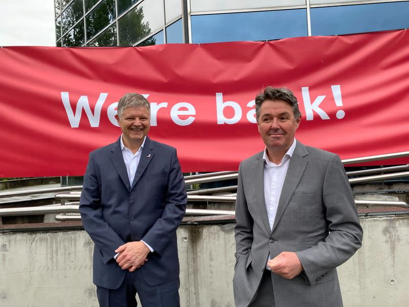Norwegian Air CEO Jacob Schram and CFO Geir Karlsen pose for a photo in Oslo